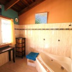 Sanctuary Bush to Beach House main bathroom - Nambucca Heads holiday rentals - holiday lettings. Mid North Coast accommodation near Valla Beach